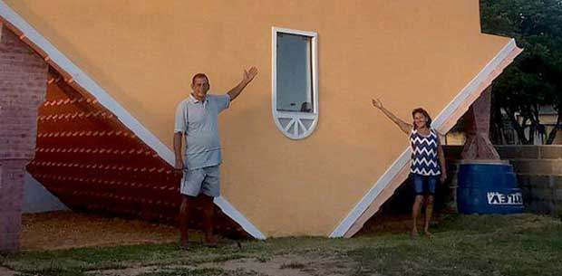 """65-year-old retiree builds """"crazy"""" upside-down house"""