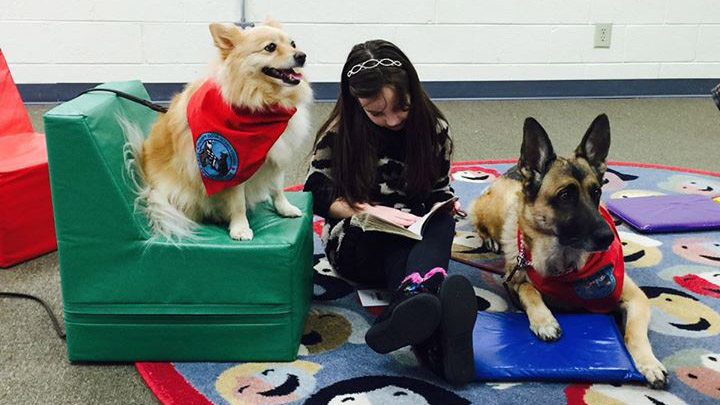 Therapy dogs are motivating kids who struggle to read