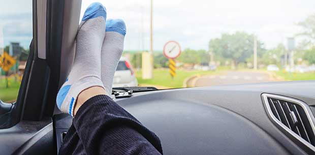 Scary reason why you should never put your feet on the dashboard of a car