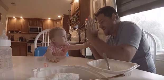 Deaf father sings in sign language to his baby daughter