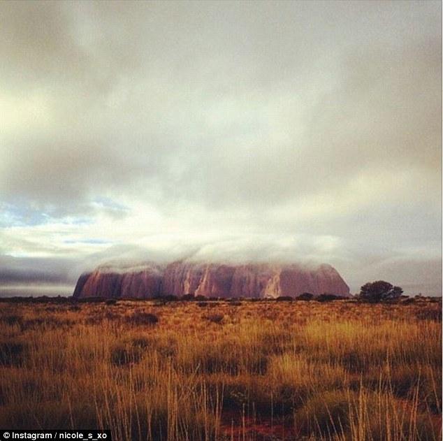 Rare sight as rain creates waterfalls on Uluru