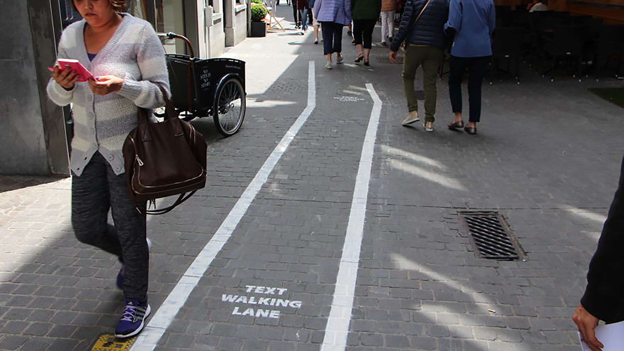 "Phone addicts get their own ""text-walking"" lanes in Belgium"
