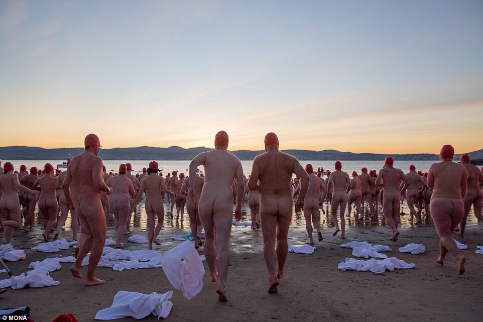 Hundreds of nude swimmers celebrate winter solstice with a dip in river