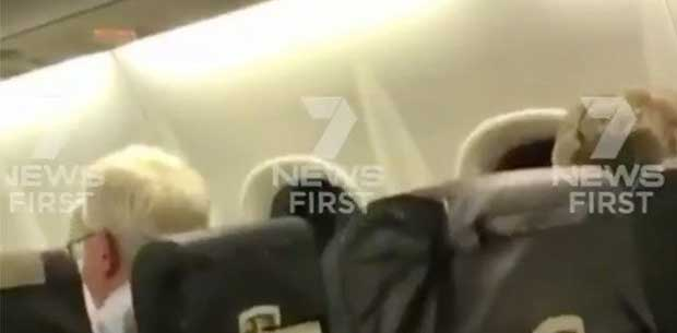 The terrifying moment a Qantas flight is battered by wild Queensland storm