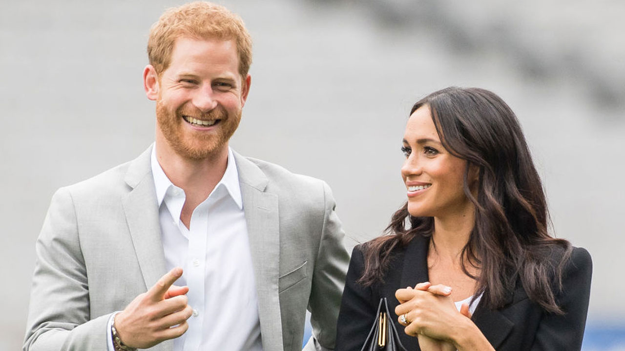 Just like us! Prince Harry and Duchess Meghan spotted catching public transport