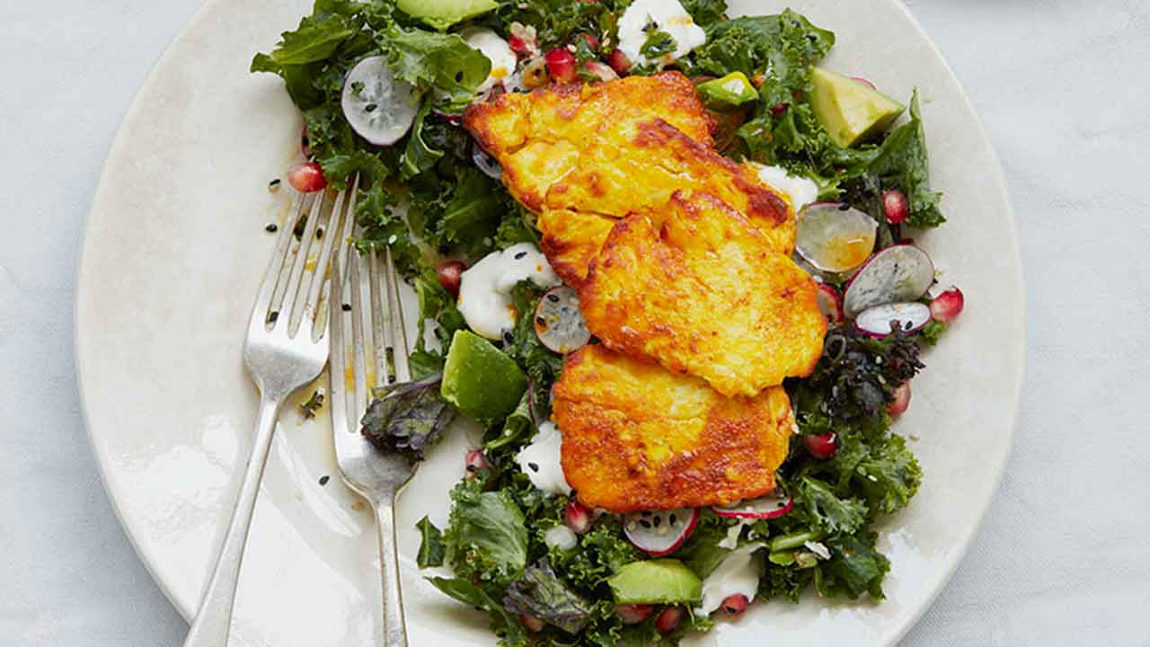 Simple grilled halloumi and kale salad with tahini yoghurt dressing