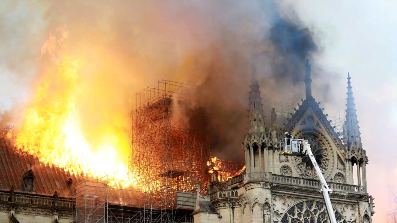 """""""Everything is burning"""": Thousands watch in horror as iconic Notre Dame cathedral blazes"""