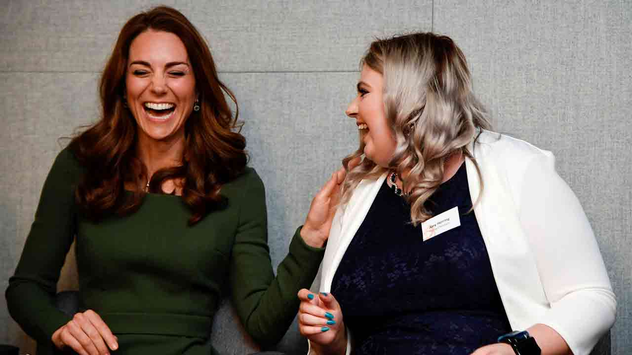 The Duchess of Cambridge and fellow speaker Amy Herring laughing.