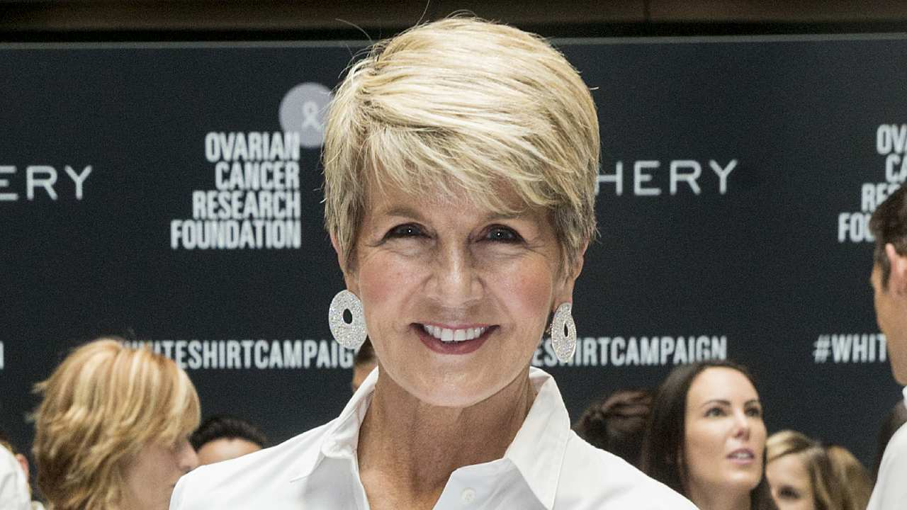 Julie Bishop struts the red carpet in daring red gown – and debuts new hairstyle
