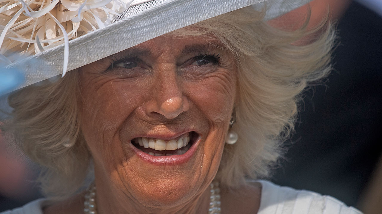 Duchess Camilla wows in white at first royal garden party of the year