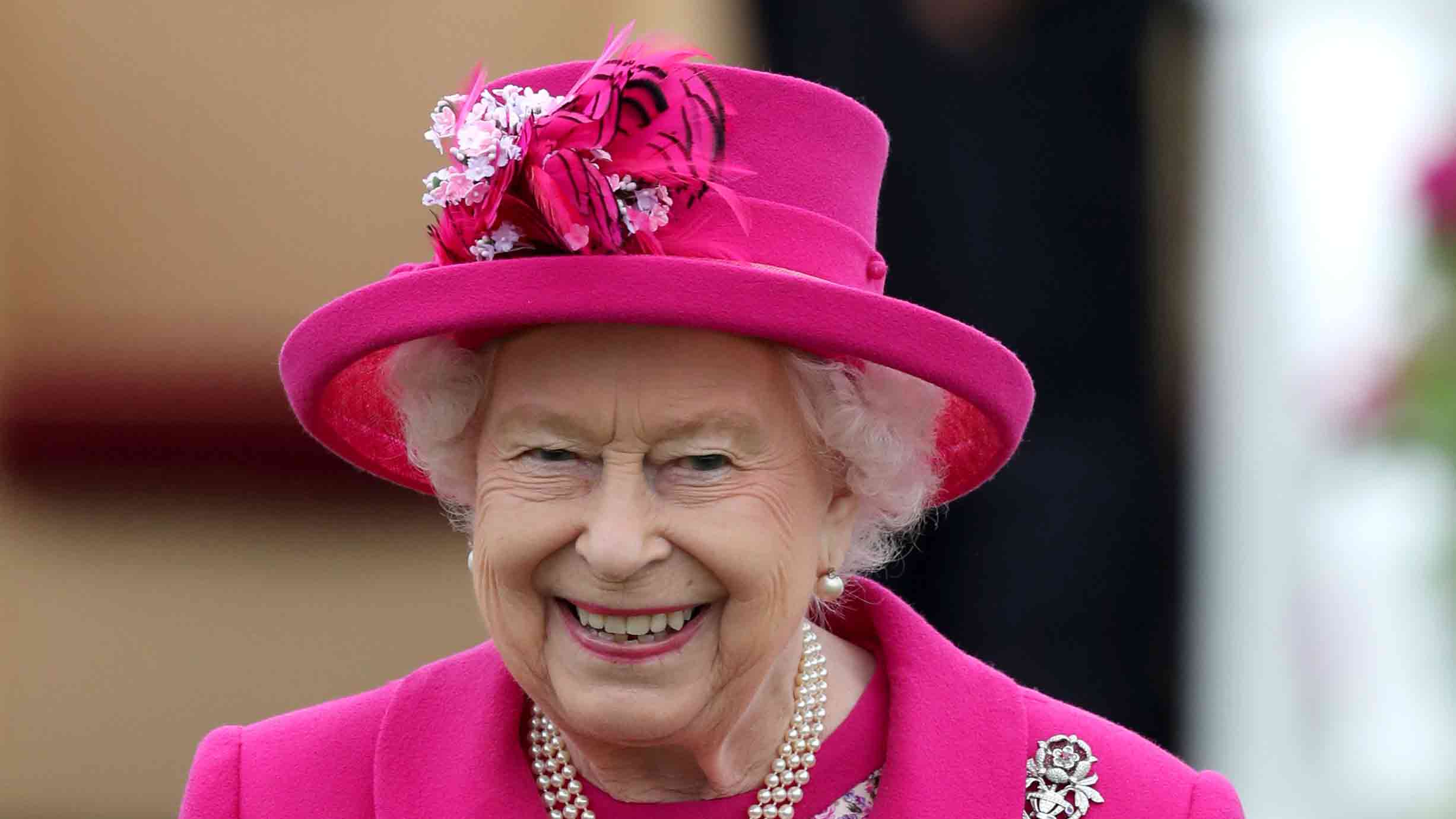 Impeccable style: Queen radiant in bold fuchsia for 6th engagement in one week