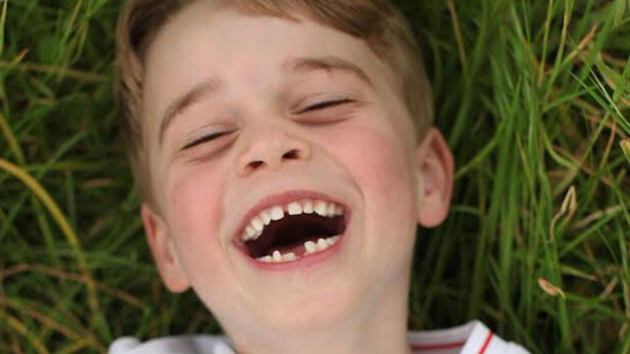 So cute! Prince George flashes toothy grin in new photos marking his 6th birthday