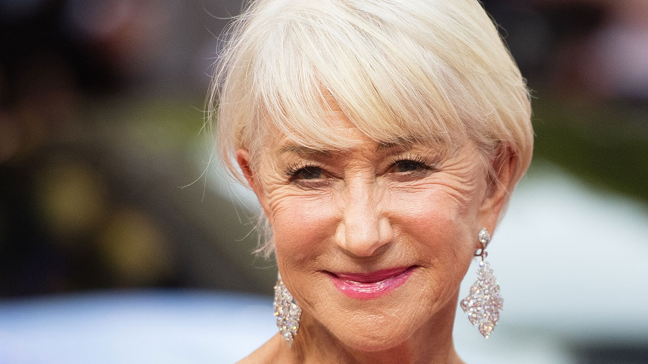 Graceful in green: Helen Mirren steps out in eye-catching dress on red carpet