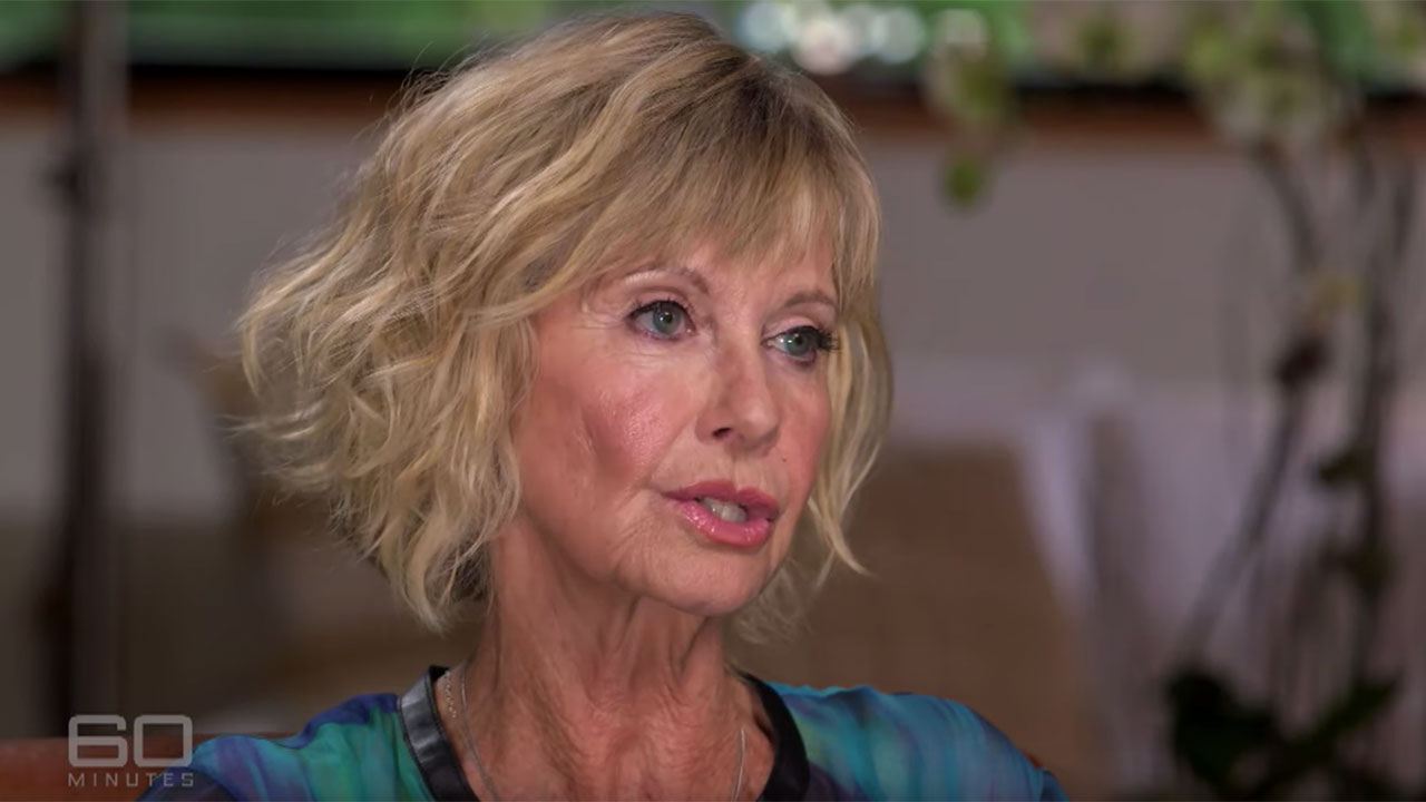 """""""I'm living with it"""": Olivia Newton-John not giving up despite advanced cancer diagnosis"""