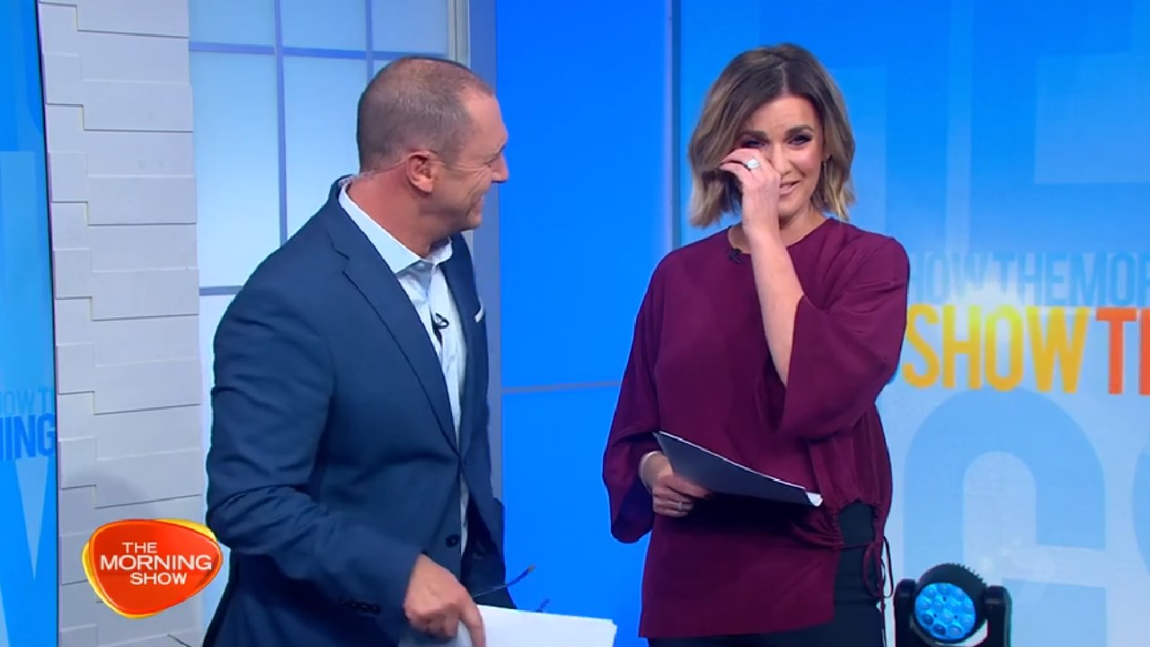 Keep it together: Larry Emdur and Kylie Gillies lose it over news story