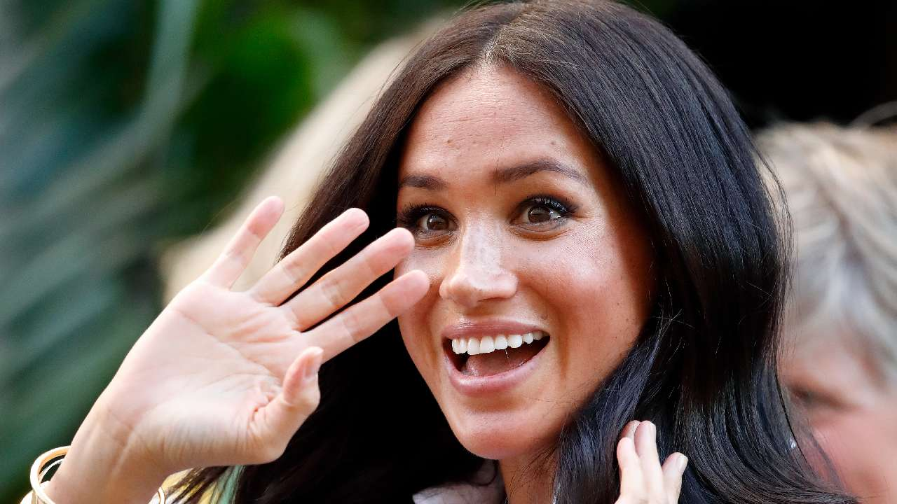Back to work! Duchess Meghan steps out in style after wrapping up maternity leave