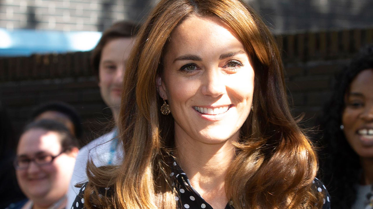 Duchess Kate is pretty in polka dots on visit to children's centre