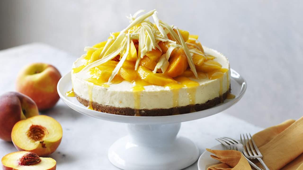 Enjoy a sweet peach cheesecake with peach syrup