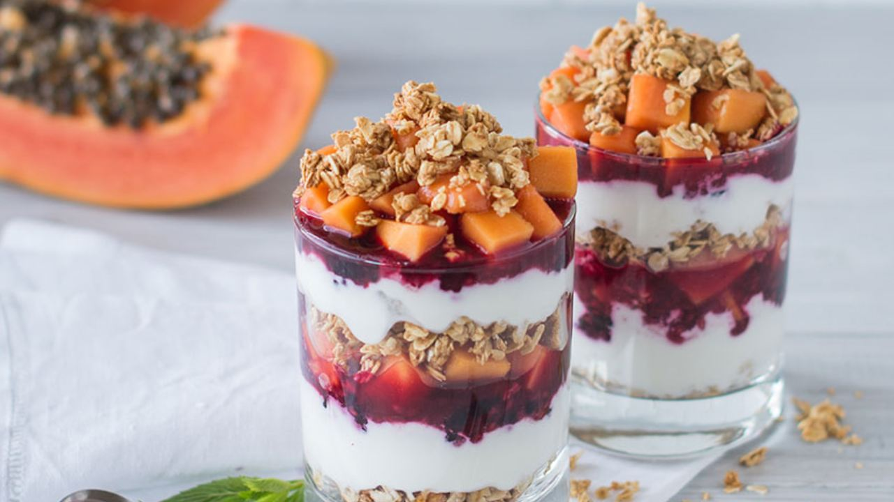 Enjoy sweet red papaya and mixed berry parfaits