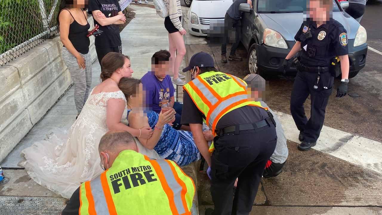 """""""Rockstar bride"""" helps victims of car crash in wedding dress"""