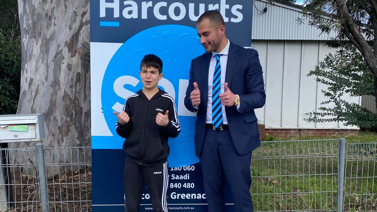 Eight-year-old boy snaps up $970,000 property at auction
