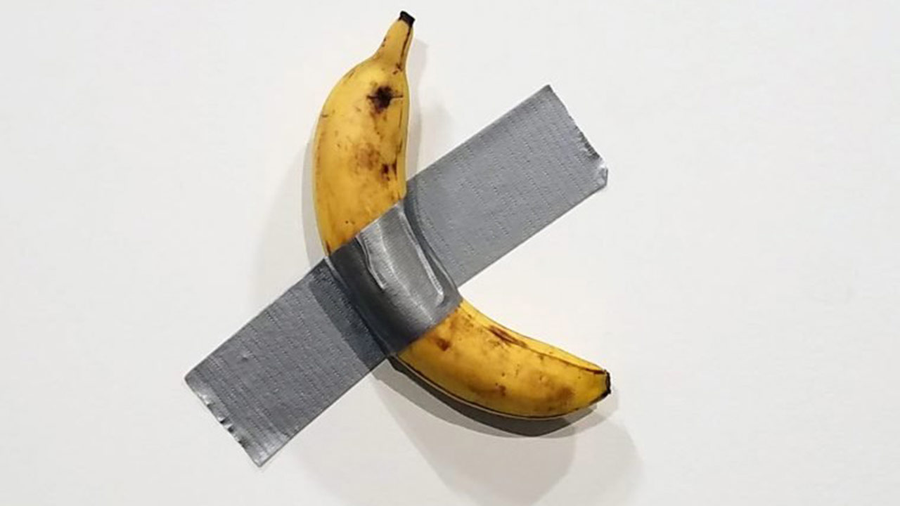 A banana duct-taped to a wall