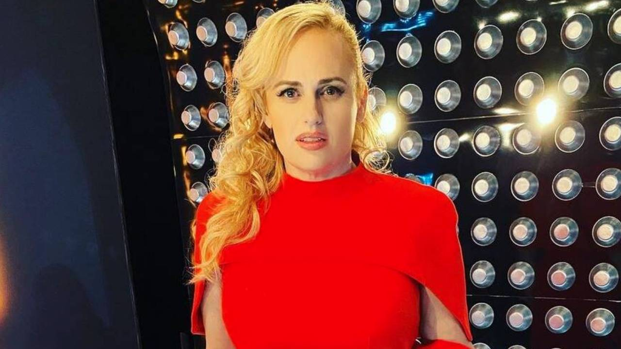 Lady in red: Rebel Wilson stuns in a Meghan Markle classic