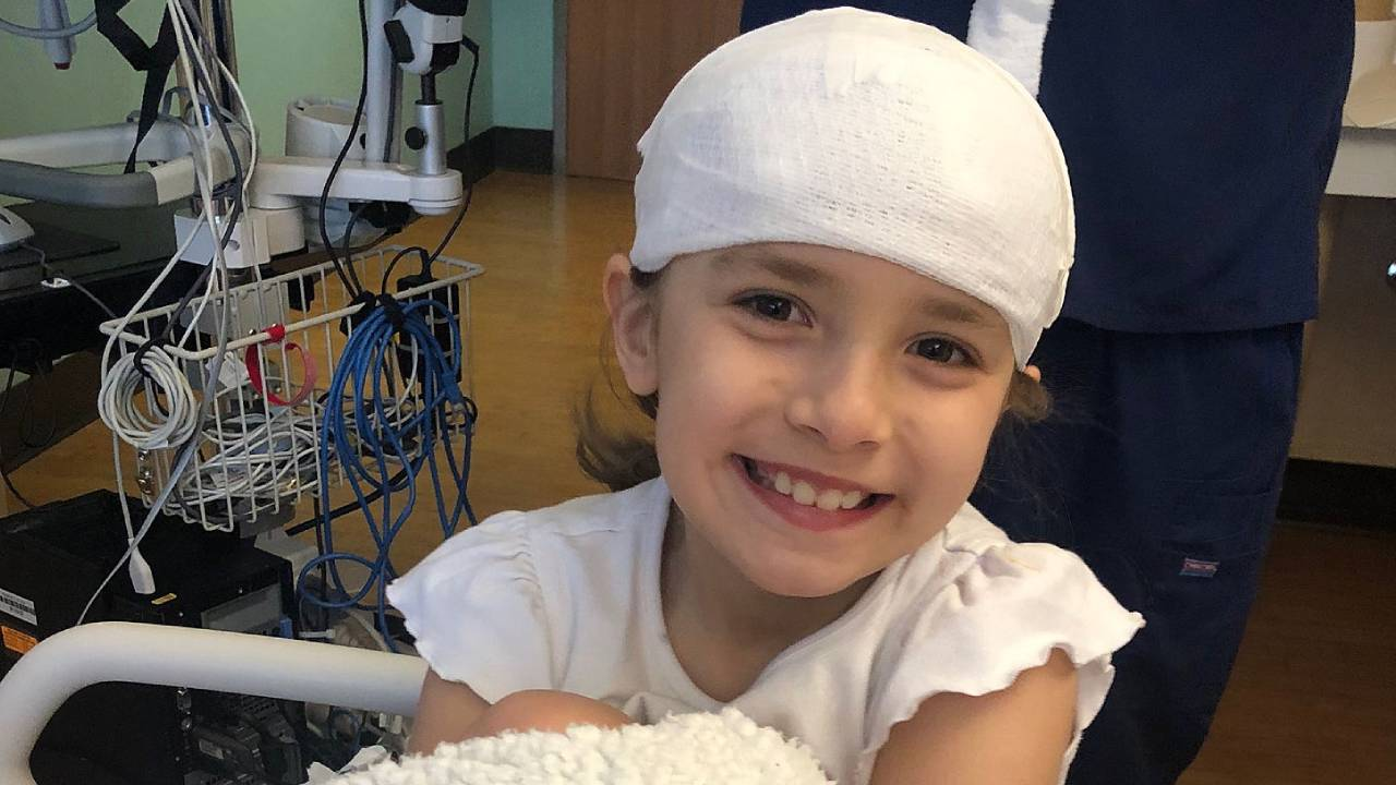 """I hope I make it"": 7-year-old works to pay for her own brain surgery"
