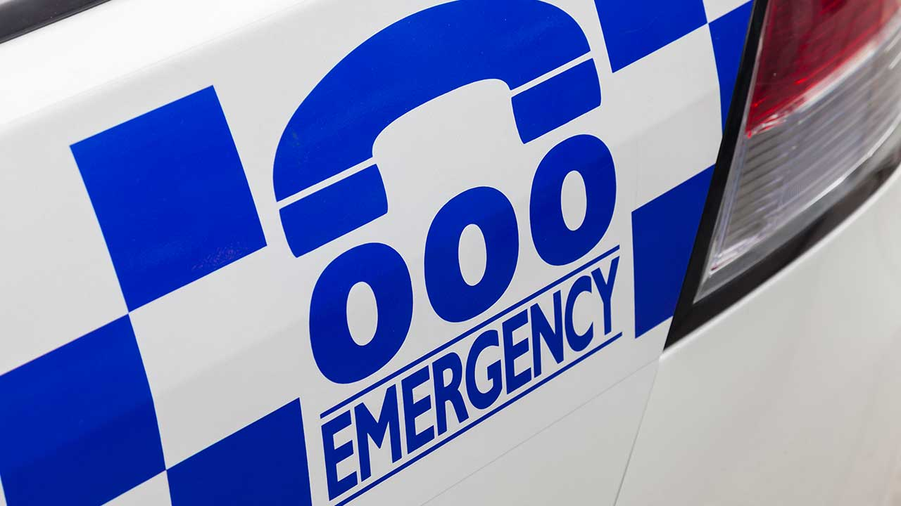 Toddler dies after family placed on hold to emergency services